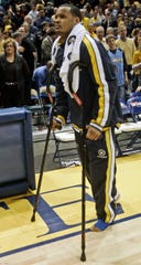 Marquette's  Dominic James fractured his foot early in the game against   UConn's  at the Bradley Center Wednesday, February 25, 2009.