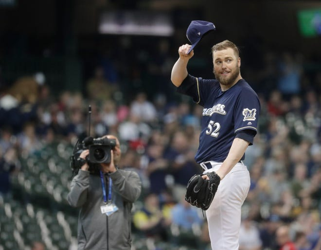 Brewers starting pitcher Jimmy Nelson acknowledges the crowd before the first inning against the Miami Marlins on June 5. Nelson returned to the mound after missing the 2018 season while recovering from a shoulder injury.