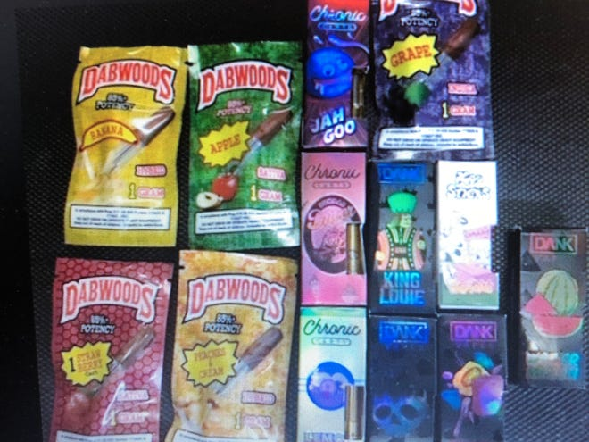 THC cartridges seized in a raid in Kenosha show candy-flavored packaging.