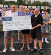 Representatives from Arvest Bank presenteda donation of $5,000 on behalf of the Arvest Foundation to the Bomber Booster Club inin memory of Lucas Todd, a Mountain Home High junior who was killed in a pedestrian accident before the beginning of this school year. The presentations were made during the Bombers' game against Harrison on Friday evening at Bomber Stadium.