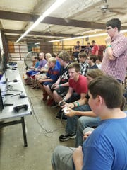 Gamers compete in last year's Super Smash Bros. tournament at the Baxter County Fair.