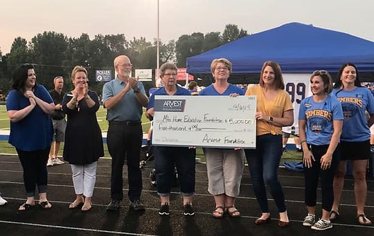 Representatives from Arvest Bank presented a donation of $5,000 on behalf of the Arvest Foundation to the Mountain Home Education Foundation in in memory of Lucas Todd, a Mountain Home High junior who was killed in a pedestrian accident before the beginning of this school year. The presentations were made during the Bombers' game against Harrison on Friday evening at Bomber Stadium.