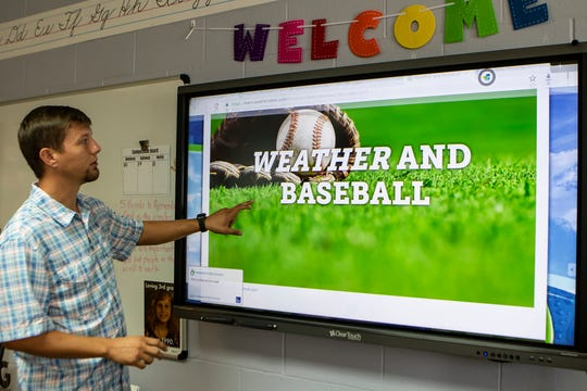 "Ouachita Christian School teacher Brandon McQuillin shows a lesson titled ""Weather and Baseball"" that he can teach in his class using data collected from the school's WeatherSTEM on Sept. 11 in Monroe, La."