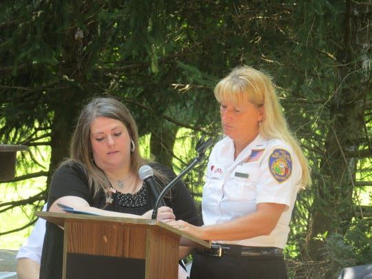 Montville first aid workers Julie Goodman and Carol DaCosta speak during the township's 9/11 memorial service at Community Park's Freedom Plaza. Sept. 11, 2019