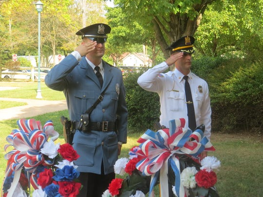 Members of the Montville Police Department stand at attention during the township's 9/11 memorial service at Community Park's Freedom Plaza. Sept. 11, 2019