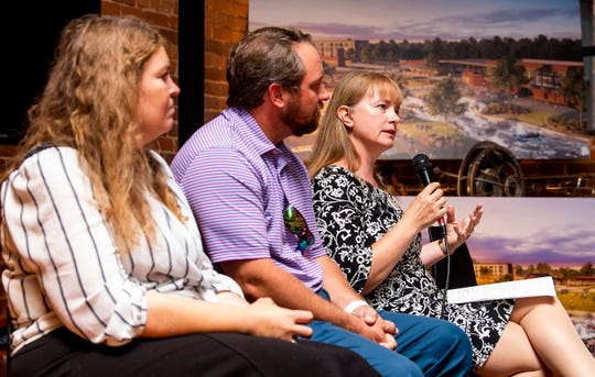Lois Cortell speaks as downtown businesses and residents discuss the whitewater park plan and other projects during a town hall meeting in downtown Montgomery, Ala., on Tuesday September 10, 2019.