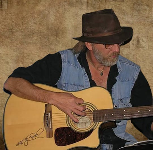 Kent Cooper performs Friday at Range 231 N. during the NASH Next competition.
