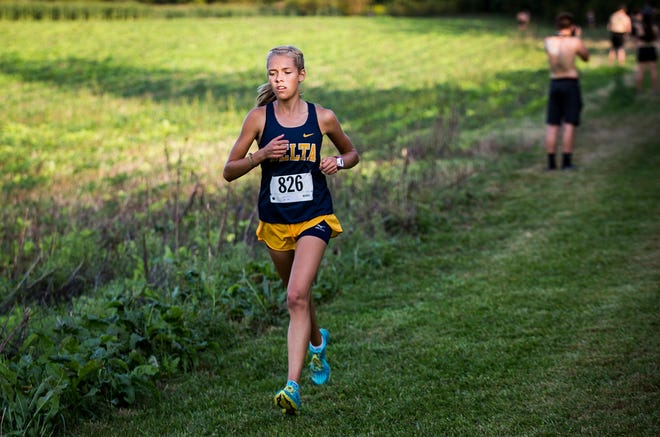 FILE -- Delta's Makayla Robles runs during the Delaware County cross country meet at Cowan High School Tuesday, Sept. 10, 2019.