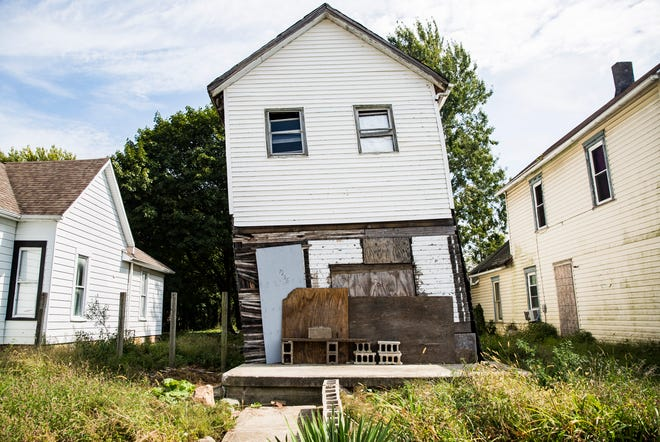Neighbors and community members have voiced concerns about a vacant home at 1225 W. Kilgore Ave. that leans to one side of its foundation.