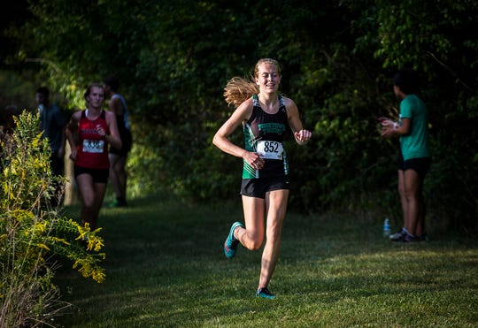Yorktown's Amberleigh Sorensen competes at Cowan High School during the Delaware County cross country meet Tuesday, Sept. 10, 2019.