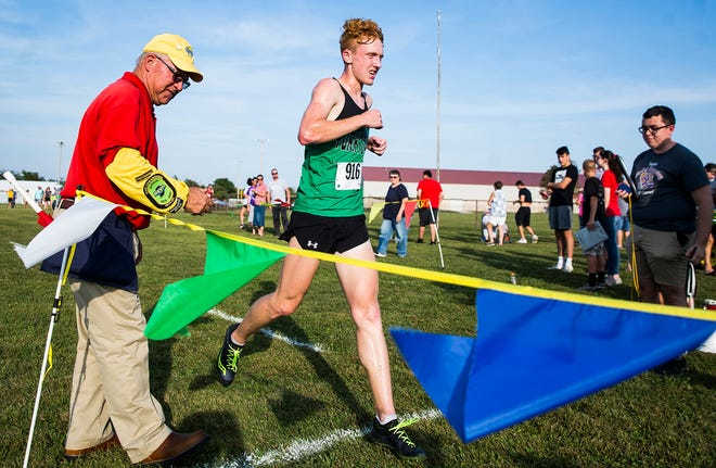 FILE -- Yorktown's Matthew Mitsch competes in the county cross country meet at Cowan High School.