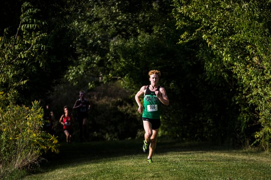 Yorktown's Matthew Mitsch runs during the county meet at Cowan High School on Tuesday, Sept. 10, 2019. Mitsch won the meet with a time of 16:44.90.