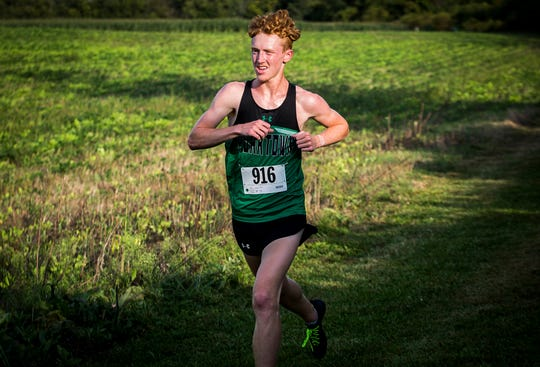 Yorktown's Matthew Mitsch competes in the county cross country meet at Cowan High School.
