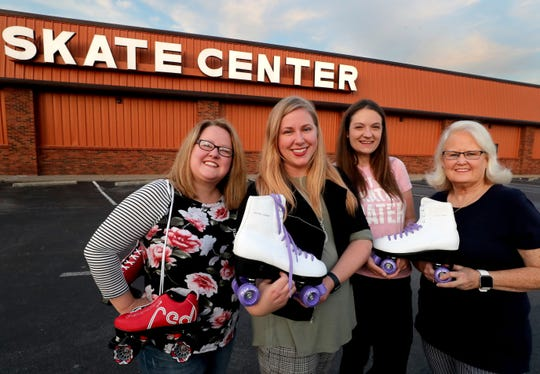 Rutherford Roller Queens, from left, Angie Windrow, Emily Thomas, Bianca Tinsley and Judy Pritchett stand in front of the Smyrna Skate Center, where they plan to have an '80s night for women. The skating group is open to women only, age 23 and older.