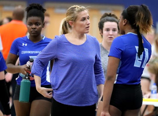 Falon Catalano talks to Rockvale volleyball players during a 2019 match. Catalano will move from volleyball to softball, where she will be the head coach in 2021.