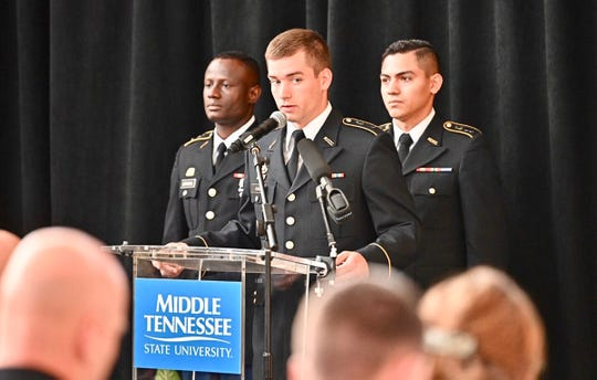 ROTC senior cadet Nick King, center, takes his turn reading the Sept. 11, 2001, timeline of events Wednesday, Sept. 11, during the fifth annual MTSU 9/11 Remembrance in the Miller Education Center atrium. Awaiting their turns to read are junior Fabrice Uwimana, left, and senior Brandon Valentin.