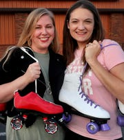 Rutherford Roller Queens founders Emily Thomas, left, and Bianca Tinsley stand in front of the Smyrna Skate Center, where they plan to have an '80s night for women.