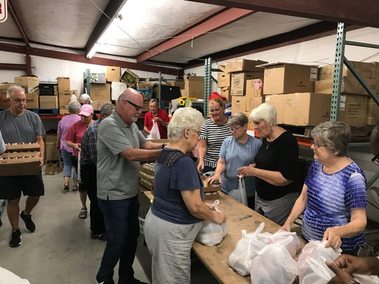 Volunteers from New Vision Baptist Church meet weekly to put together backpack meals for Murfreesboro City Schools students who are food insecure.