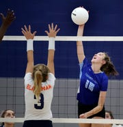 Rockvale's Isabell Greene (16) hits the ball over the net as Blackman's Hannah Johnson (3) guards the net at Rockvale on Tuesday Sept. 9, 2019.