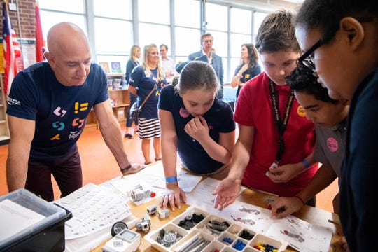 Amazon CEO Jeff Bezos watches as students work together at Madison Middle School Wednesday, Sept. 11, 2019, in Nashville, Tenn.