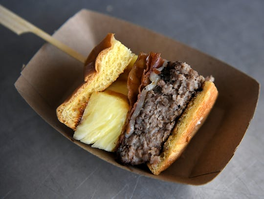A sample of the Number 8 burger was part of the Tennessee Titans unveiling its new and regular fan food itemsfor 2019 season at Nissan Stadium on Sept. 11, 2019.