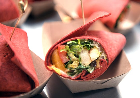 A sampling of a chicken wrap was part of the Tennessee Titans new and regular fan food items for 2019 season at Nissan Stadium on Sept. 11, 2019.