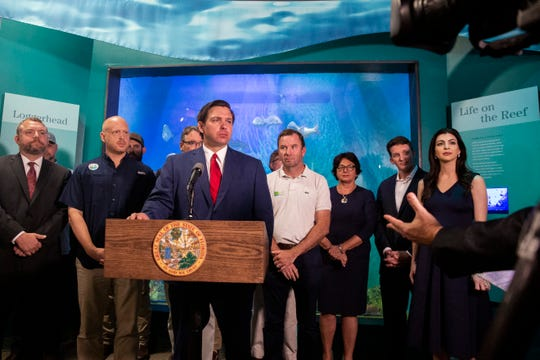 Governor Ron DeSantis announces about recurring funding to Everglades restoration and increasing the Department of Environmental Protection fines for wastewater violations during a press conference at the Conservancy of Southwest Florida Nature Center on Wednesday, September 11, 2019.