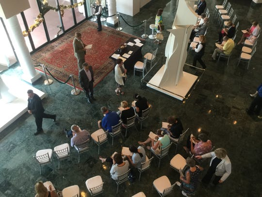 Job applicants start to fill up the lobby seats at Artis--Naples.