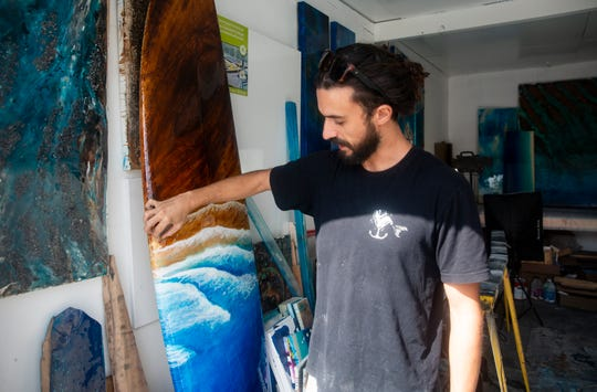 Brandon Bowe talks about his work, Wednesday, Sept. 11, 2019, at his workspace in North Naples.
