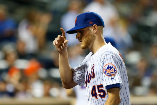 Sep 10, 2019; New York City, NY, USA; New York Mets starting pitcher Zack Wheeler (45) acknowledges fans on his way to the dugout in the seventh inning against the Arizona Diamondbacks  at Citi Field.