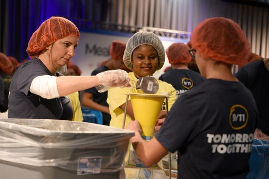 "Volunteers commemorate the anniversary of the Sept. 11, terror attacks by packing meals for the needy at the Intrepid Sea, Air & Space Museum during a day of service organized by ""9/11 Tomorrow Together,"" on September 11, 2019."