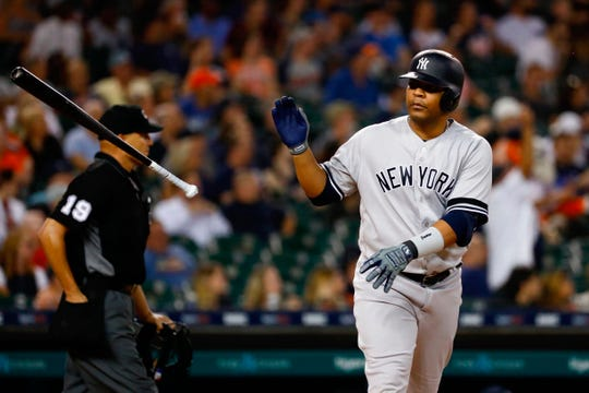 Sep 10, 2019; Detroit, MI, USA; New York Yankees designated hitter Edwin Encarnacion (30) tosses his bat after he hits a two run home run in the seventh inning against the Detroit Tigers at Comerica Park.