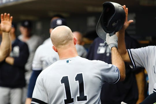 Sep 10, 2019; Detroit, MI, USA; New York Yankees left fielder Brett Gardner (11) receives congratulations from teammates after he hits a two run home run in the second inning against the Detroit Tigers at Comerica Park.