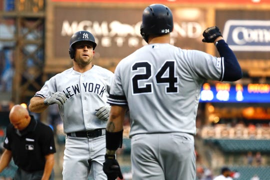 Sep 10, 2019; Detroit, MI, USA; New York Yankees left fielder Brett Gardner (11) receives congratulations from catcher Gary Sanchez (24) after he hits a two run home run in the second inning against the Detroit Tigers at Comerica Park.
