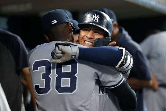 New York Yankees' Gleyber Torres celebrates his solo home run with Cameron Maybin (38) in the fourth inning of a game against the Detroit Tigers in Detroit, Tuesday, Sept. 10, 2019.