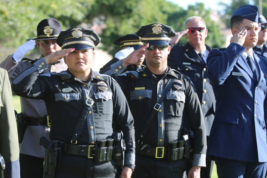 Members of multiple law enforcement agencies gather at Horseshoe Park in Las Cruces, Wednesday Sept. 11, 2019, to commemorate the 18th anniversary of the September 11, 2001 terrorist attacks that killed nearly 3,000 people in New York City, Pennsylvania and Washington D.C.