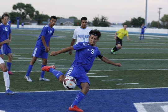 Carlsbad's Jesus Zamora loads up for a shot during Tuesday's game at Ralph Bowyer Caveman Stadium against Goddard. Zamora finished with three goals and Carlsbad won, 5-0.