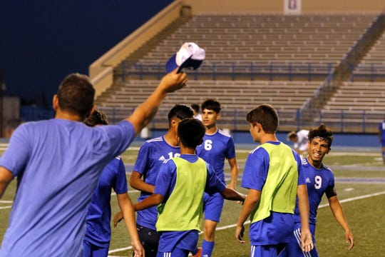 Carlsbad assistant coach Aaron Guevarra raises his hat to Jesus Zamora (9) after Zamora scored his third goal of the game against Goddard, giving him a hat trick on Tuesday at Ralph Bowyer Caveman Stadium. Carlsbad won, 5-0.