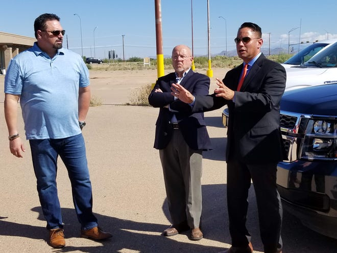 New Mexico Lt. Gov. Howie Morales, District 33 Sen. William Burt, R-N.M., and Medlin Ramps, Inc. CEO Mark Medlin discuss a status update of the old Walmart building at 1900 Hwy 54 South, on Sept. 11, 2019.