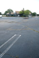 The former L'Esprit Academy property features a large, wide parking lot.