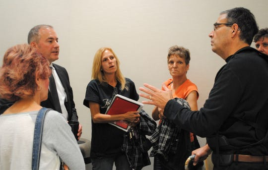 Westland Mayor Bill Wild, left, talking to residents after the meeting.