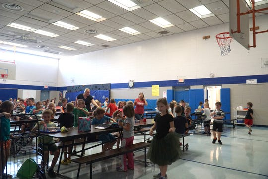 Huron Valley Schools would like to enlargen Lakewood Elementary's combination cafeteria and gymnasium for its students - giving the school more scheduling options.