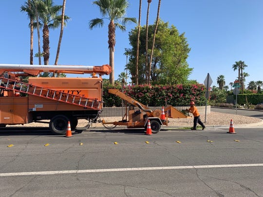 A worker for Utility Tree Service, Inc., a landscaper specializing in utilities contracts across multiple counties in California and Oregon, fed a branch into a wood chipper on Sunny Dunes Road, August 23, 2019.