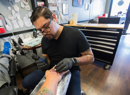 Artist Jimmi Miara Calva works on a tattoo for Chandler Gray on September 10, 2019 in Cathedral City.