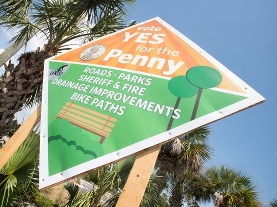 """Vote Yes for the Penny"" signs are displayed along Gulf Breeze Parkway in Gulf Breeze on Wednesday. The signs are paid for by a political action committee called Moving Santa Rosa Forward."