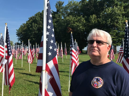 Ken Raleigh visits the flag display at West Manheim Elementary School on Wednesday, Sept. 11, 2019.