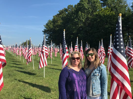 Veronica Church, left, and her daughter Heather Church visit the flag display at West Manheim Elementary School on Wednesday, Sept. 11, 2019.