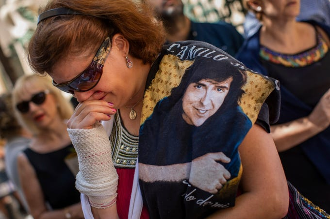 Mourners queue to see the coffin of singer/songwriter Camilo Sesto in Madrid on Monday, Sept. 9, 2019.