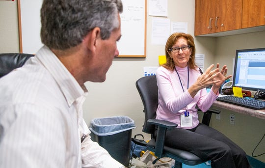 Dr. Frank Dalichow, left, and Dr. Johanna Di Mento, oncologists at Tuba City Regional Health Care, work in their office, Friday, August 9, 2019.  The couple are married and the only oncologists on the Navajo Nation.