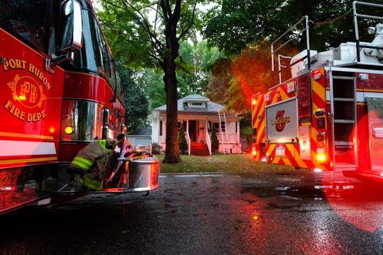 Port Huron firefighters respond to a house fire on Cedar Street on Wednesday, Sept. 11, 2019, during a severe thunderstorm